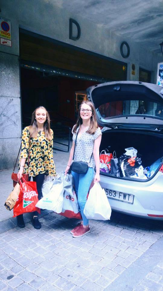 Georgie and her friend Hannah unloading bags of donated shoes at the refugee centre.