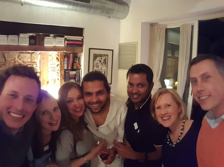 Some of the MFR team with guests enjoying the Chefugee dinner cooked by Khaled (centre).