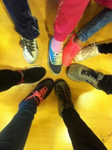 Children wearing some of their new shoes collected through the donation drive.